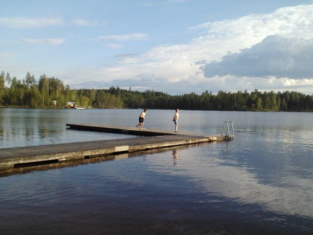Warm evening bath at beach by the lake