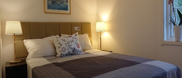 Double bed in bedroom at Premium Apartment